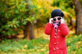 Adorable little girl on autumn day — Stock Photo
