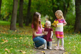 Young mother and her two daughters — Stock Photo