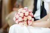 Bride holding flowers — Stock Photo