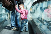 Toddler girl and her father on an escalator — Stock Photo