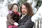 Toddler girl and her father on a winter day — Stock Photo