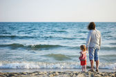 Happy father with his daughter on a beach — Stock Photo
