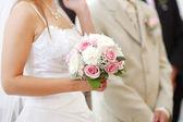 Bride holding bride bouquet — Stock Photo