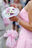 Bridesmaid with bouquet — Stock Photo
