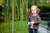 Adorable little girl portrait outdoors — Stock Photo