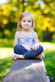 Adorable little girl portrait outdoors — Stock Photo