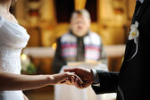 Bride and groom holding each other's hands — Stock Photo