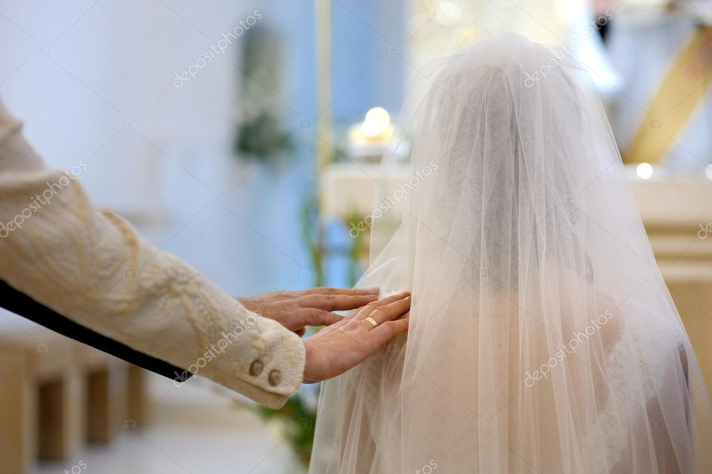 Bride's parent blessing her during wedding ceremony in a church  Stock Photo #13725343