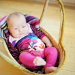 Baby girl lying in a basket — Stock Photo