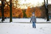 Little girl having fun at winter city — Stock Photo