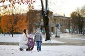 Family having fun at winter city — Stock Photo
