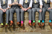 Colorful socks of groomsmen — Stock Photo