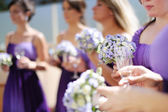 Row of bridesmaids with bouquets — Stock Photo