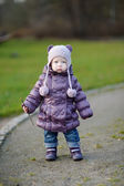 Adorable girl having fun on early spring — Stok fotoğraf