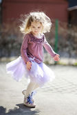 Adorable girl having fun on spring — Stock Photo