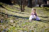 Adorable girl having fun on spring — Stock Photo