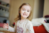 Adorable little girl laughing — Stock Photo