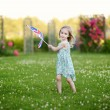 Adorable little girl with United Kingdom flag — Stock Photo