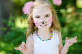 Adorable little girl with painted face — Stock Photo