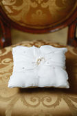 Two wedding rings on a pillow — Stock Photo