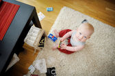 Adorable baby girl making a mess — Stock Photo
