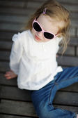 Adorable little girl in sunglasses — Stock Photo