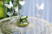 Some wine glasses decorated with butterflies — Stock Photo