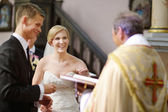 Bride and groom at the church — Stock Photo