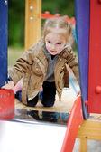 Adorable girl having fun on a playground — Foto de Stock