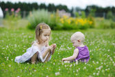 Two sisters playing outside — Stock Photo