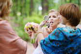 Beautiful bride getting ready for a wedding — Stock Photo