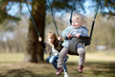 Swinging sisters having fun — Stock Photo