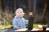 Adorable toddler girl camping — Stock Photo