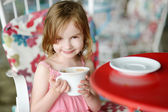 Adorable little girl drinking hot chocolate — Stock Photo