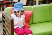 Adorable little girl drinking milkshake — Stock Photo