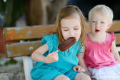 Two little sisters eating ice cream — Photo