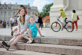 Young mother and daughter on a beautiful day — Stock Photo