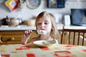 Adorable girl eating ice cream — Stock Photo