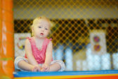 Little girl having fun at the playground — Stock Photo