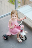 A girl on a small bike — Stock Photo