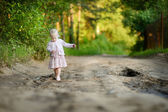 Little girl having a walk in the woods — Photo