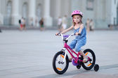 Little girl riding a bike — Stock Photo