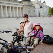 Urban biking - young mother in a city — Stock Photo