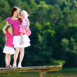 Young mother and her two daughters — Stock Photo #43460913