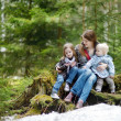 Young mother and her two daughters outdoors — Stock Photo #43460919
