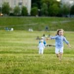 Adorable girl running around outdoors — Stock Photo