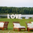Huge LOVE letters as a fancy wedding decoration — Stock Photo #43461061