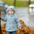 Adorable toddler girl at rainy day — Stock Photo #43462897