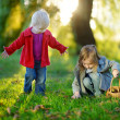 Two little sisters playing outside — Stock Photo #43462903