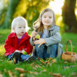 Two little sisters playing outside — Stock Photo